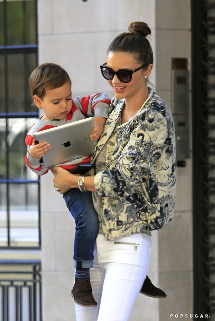 Miranda Kerr held onto her son, Flynn, as he played with an iPad.