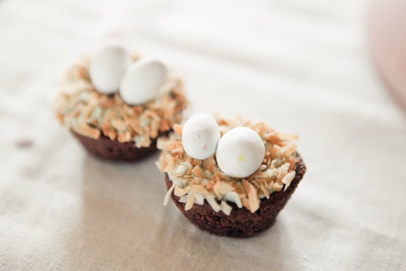 "For a cute, clever touch, Jenny nested candy ""eggs"" on top of cupcakes. Source: Kaylee Eylander Photography via Jenny Cookies"