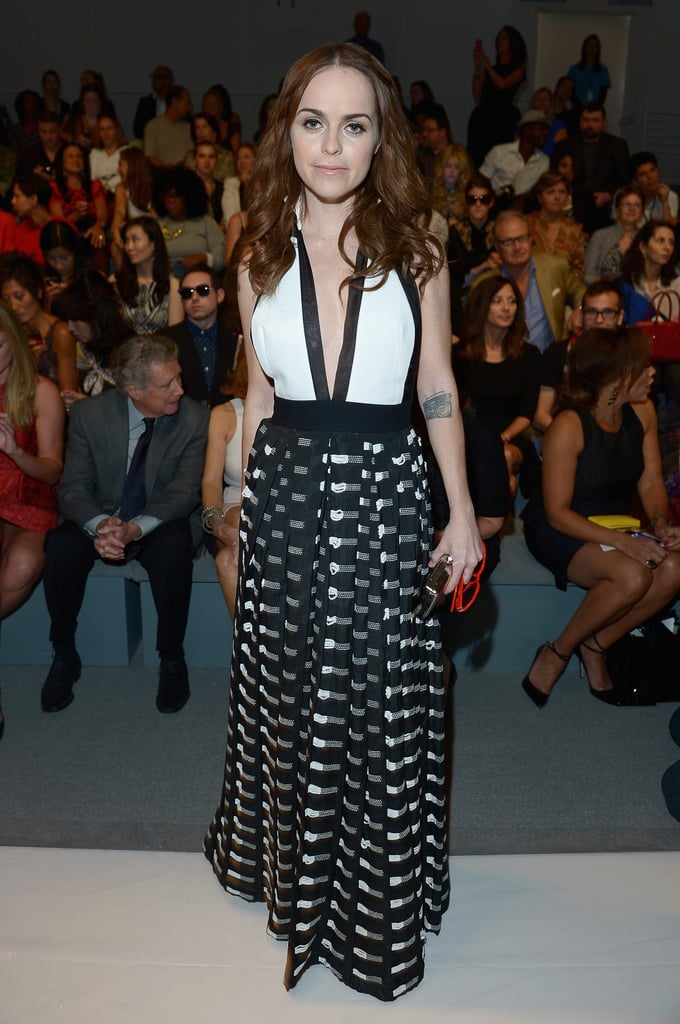 Taryn Manning sported a low-cut dress at Friday's Carmen Marc Valvo show.