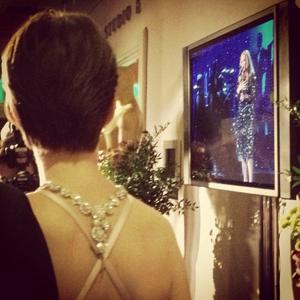 Anne Hathaway took a moment to watch Adele's performance backstage. Source: Instagram user theacademy