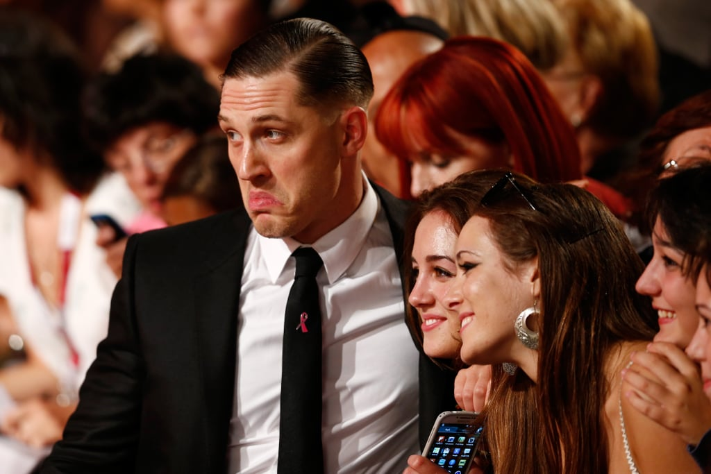 Tom Hardy made a funny face while taking pictures with fans at the Venice Film Festival.