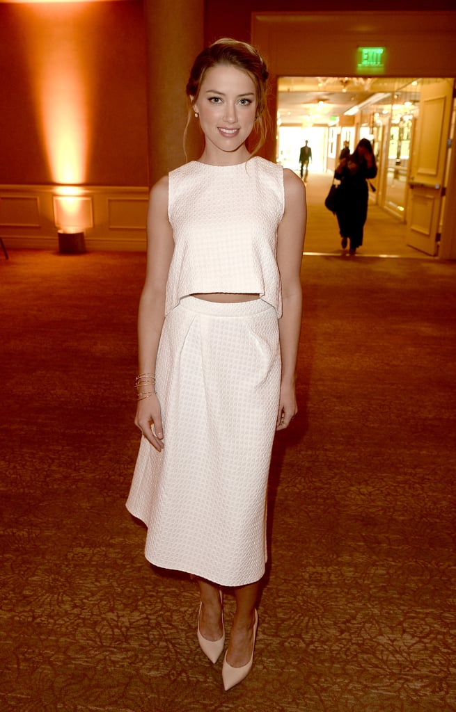 A slit of skin added extra va-va-voom to her relaxed white design at the Hollywood Foreign Press Association's 2013 Installation Luncheon.