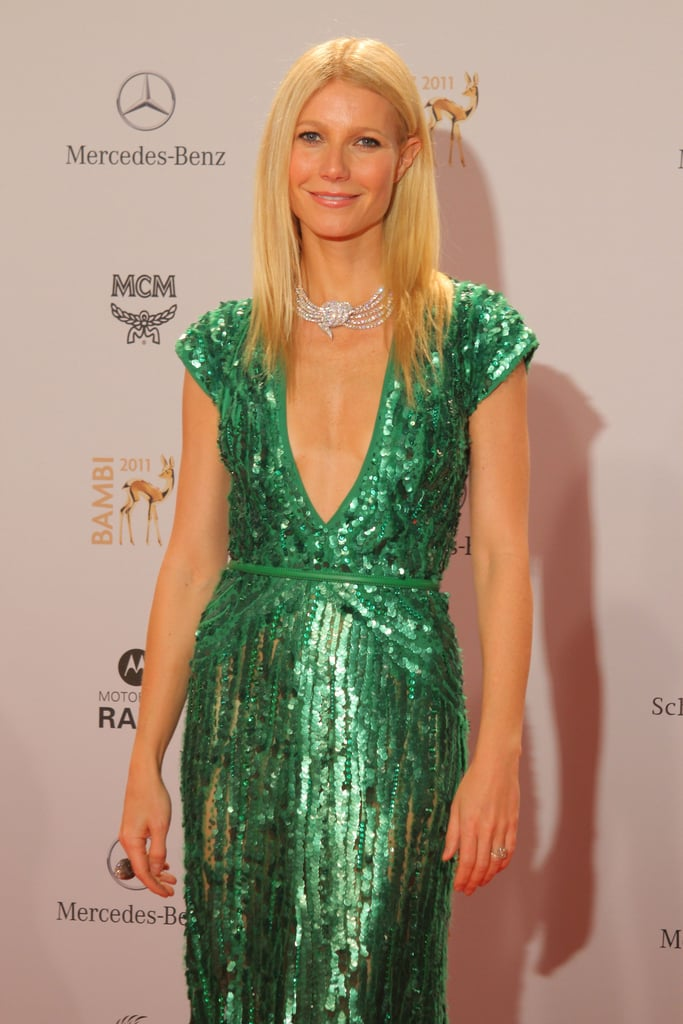 Gwyneth Paltrow on the red carpet in a green gown at the 2011 Bambi Awards.