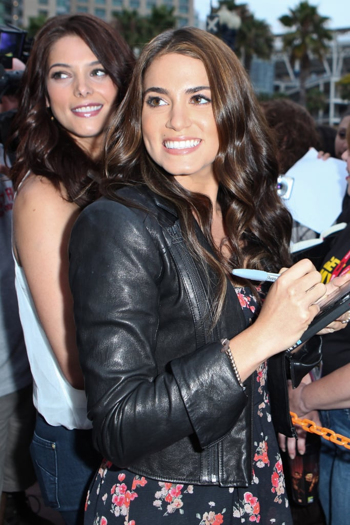 Nikki Reed and Ashley Greene signed autographs for fans in 2011.