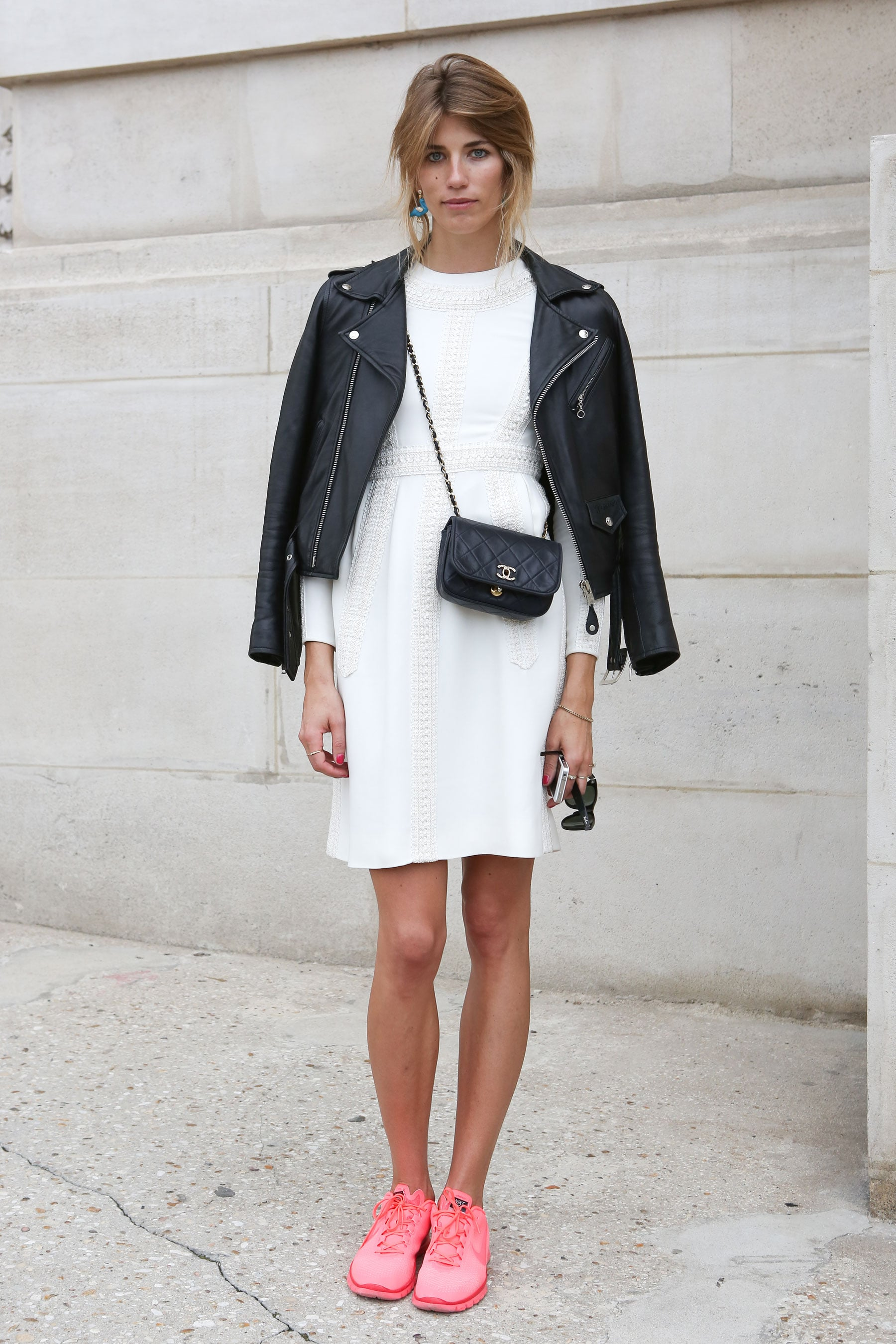 If you ever thought you couldn't wear your Nikes with your day dresses without looking like a shot out of Working Girl, this look will prove you wrong. Her white dress and stylish leather jacket are the perfect foil for fresh athletic kicks.
