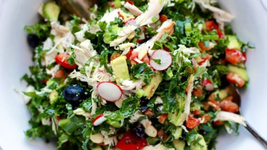 The One Topping Everyone Puts In Their Salad That's Actually Super Unhealthy