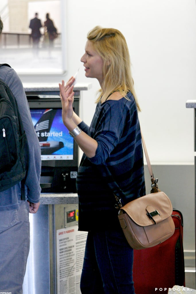 Claire Danes headed through security at LAX.