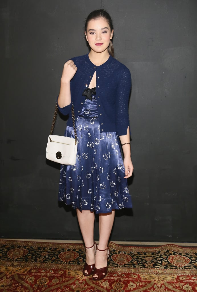 Hailee Steinfeld attended the Marc Jacobs show wearing a lovely blue ensemble, including a silky printed dress and cropped cardigan.