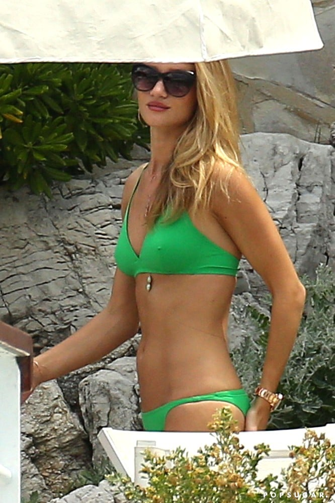 Rosie Huntington-Whiteley wore a bright green bikini.