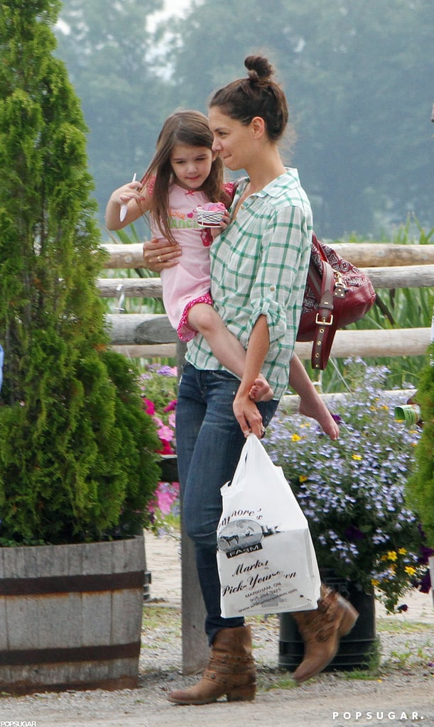 Katie Holmes and Suri Cruise enjoyed a day of strawberry picking at a farm in Ontario in June 2010.