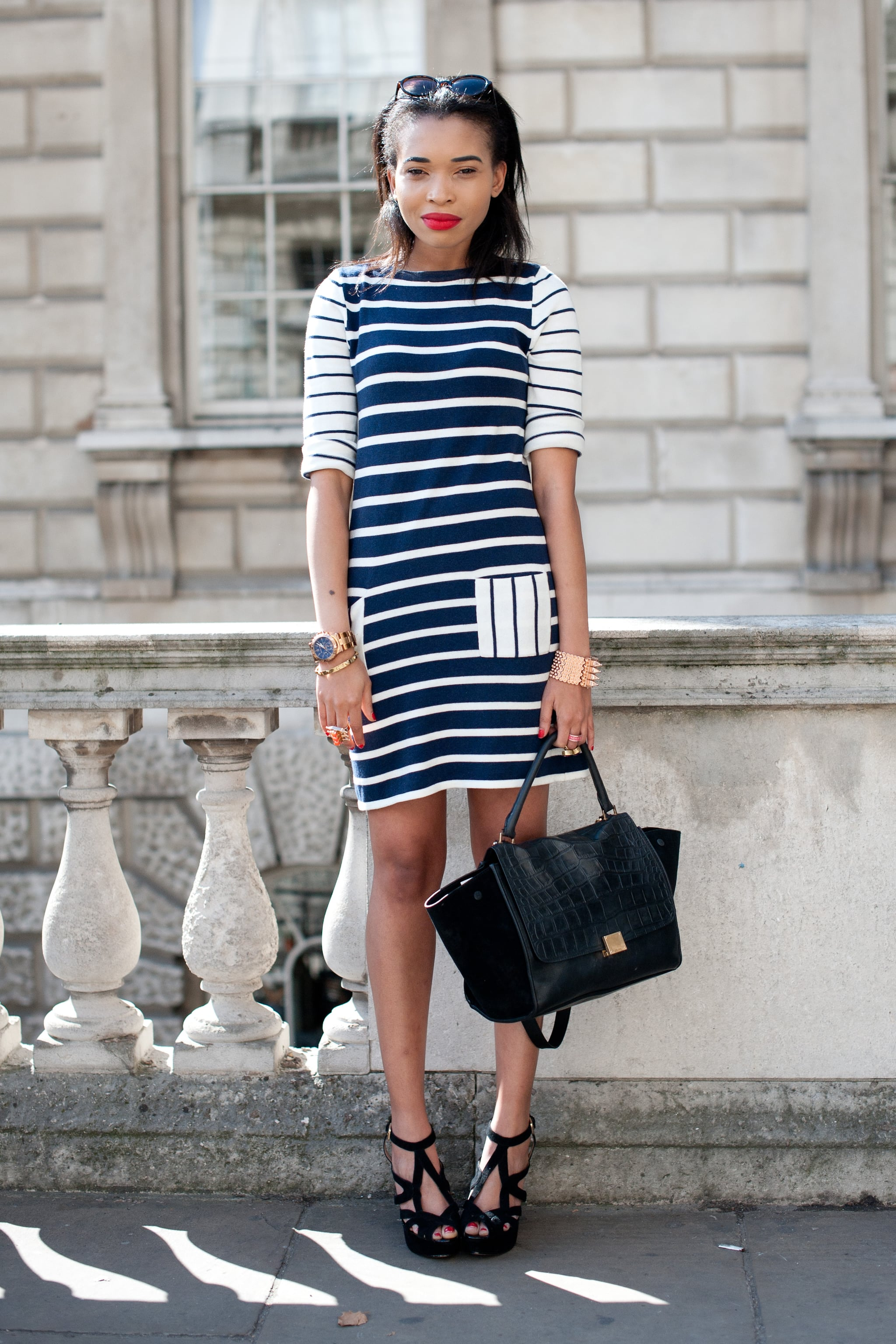 A summery nautical-striped dress gets its polished finish via a Céline bag and sexy strappy heels.