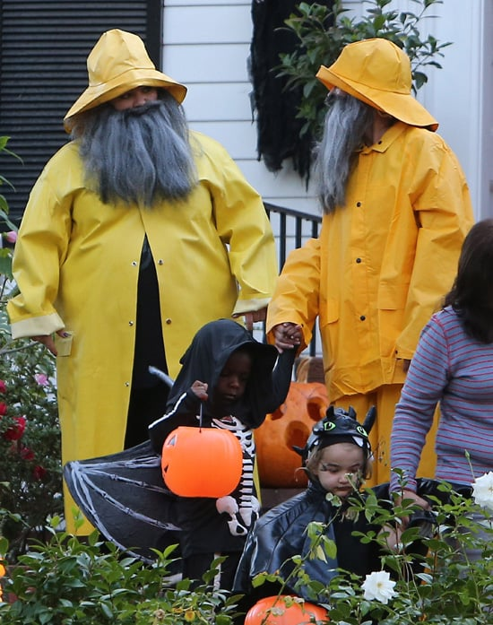 Friends Sandra Bullock and Melissa McCarthy dressed up as fishermen when they took their children out trick-or-treating in LA on Thursday night.