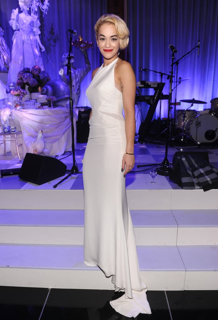 British singer Rita Ora looked every bit the retro glamour girl in a slinky white Emilio Pucci halter-neck gown.