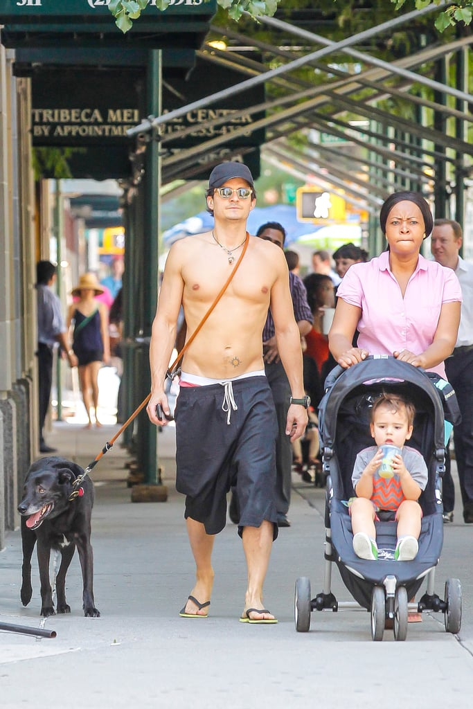 A shirtless Orlando Bloom walked alongside his son Flynn and their nanny in NYC.