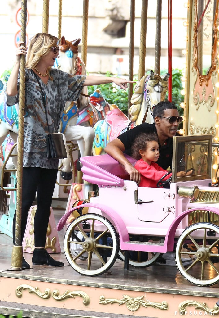 Ellen Pompeo, Stella Ivery, and Chris Ivery rode the carousel together.