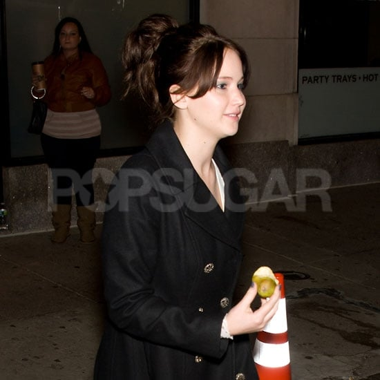 Jennifer Lawrence refueled on a piece of fruit after filming.