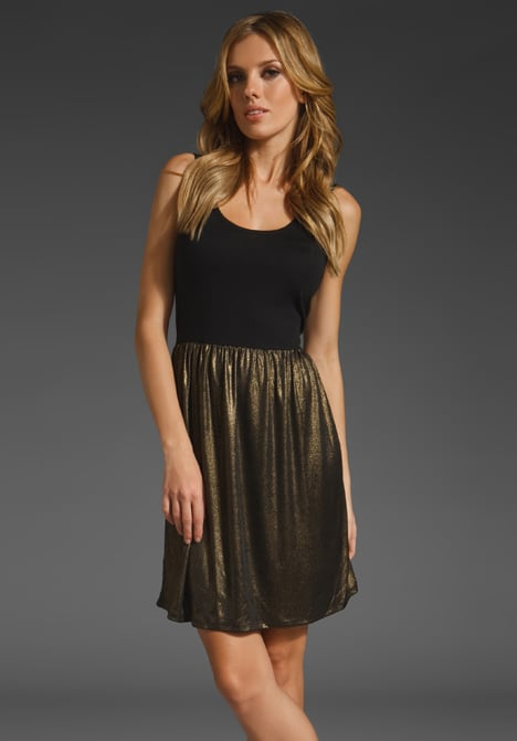 An easy silhouette with a perfectly festive vibe — for under $50.  Bobi Sparkle Stretch With Black Solid Modal Jersey Dress (approx $48)