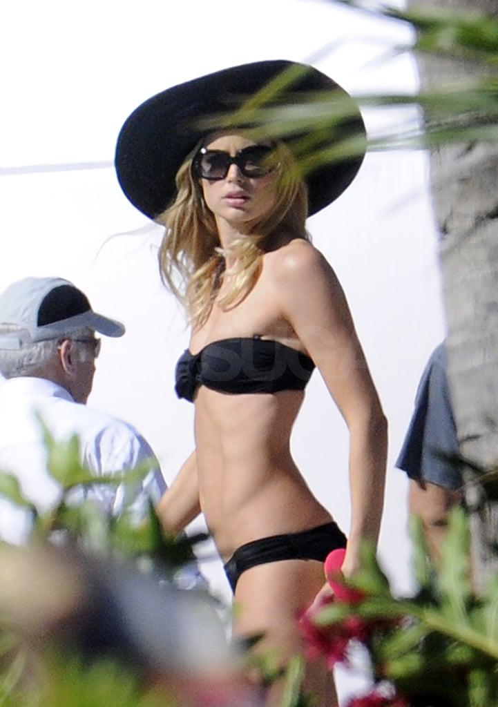 Doutzen wore a black bikini during the commercial shoot.