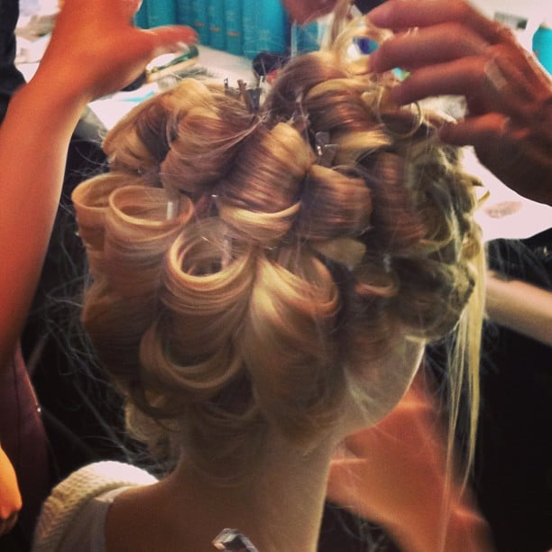 Want to know how to keep your curls bouncy all night? Pin curls, like the ones spotted backstage at Badgley Mischka.