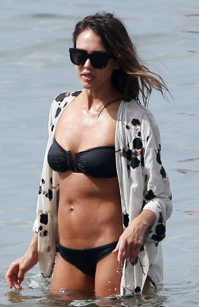 In March 2016, Jessica Alba gave us yet another look at her amazing abs while wading in the ocean in Hawaii.