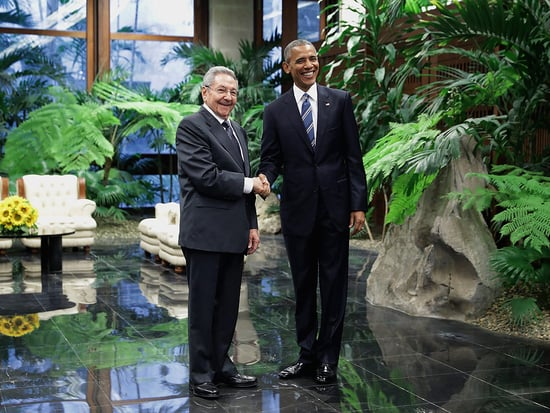 Obama Shakes Hands with Cuban President Raul Castro During Historic Trip to Cuba