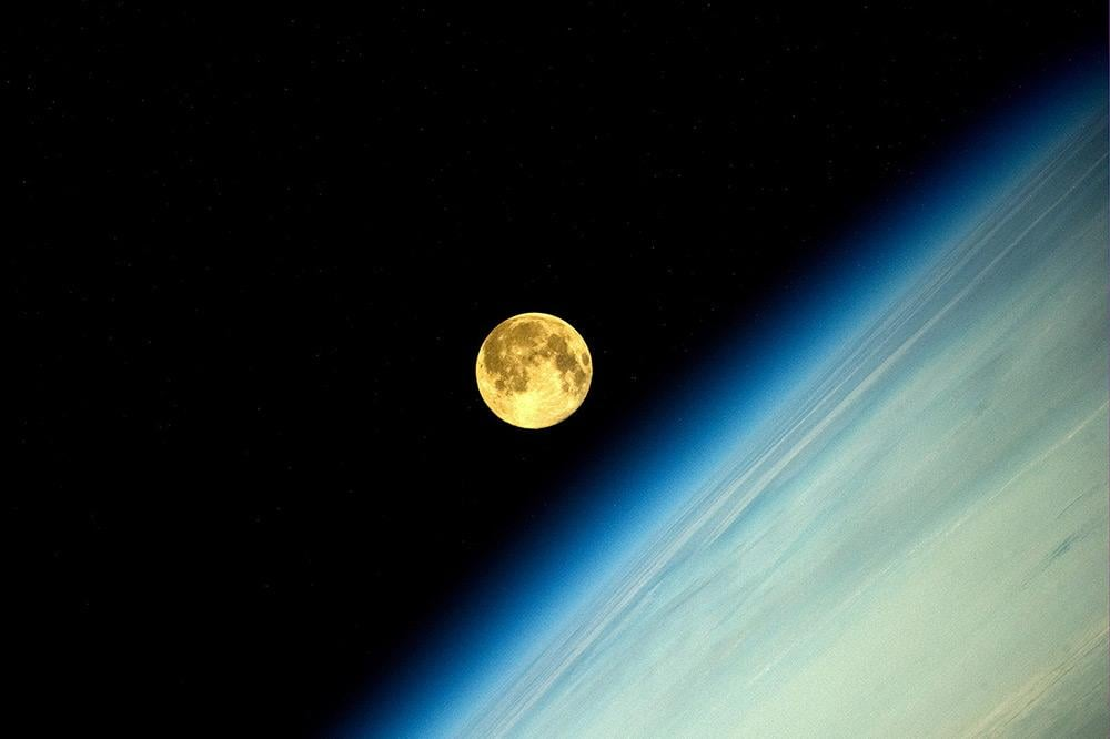 "Russian astronaut Oleg Artemyev witnesses an amazing supermoon ""moonset"" from the International Space Station on Aug. 10."