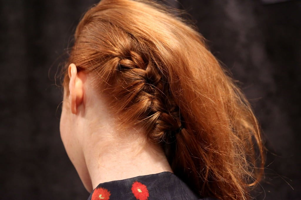 To create the illusion of shaved sides, Syfu braided hair back in a diagonal on one side. She used Anti-Frizz Secret Crème on her fingers to smooth the hair while pulling it tight.