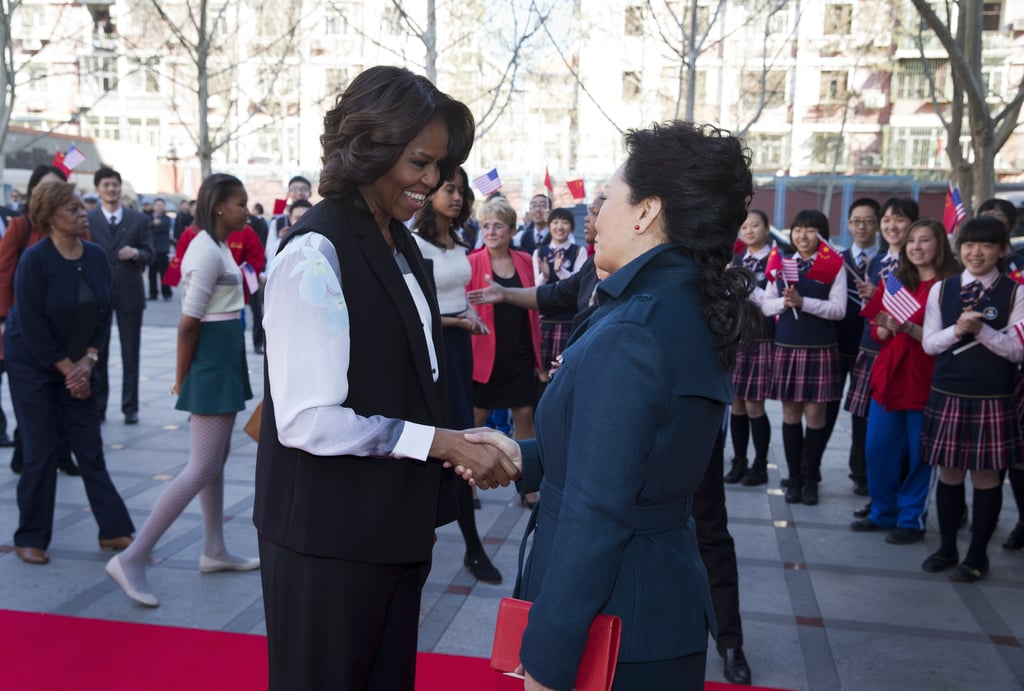 Students holding American flags were on hand to welcome the first lady.