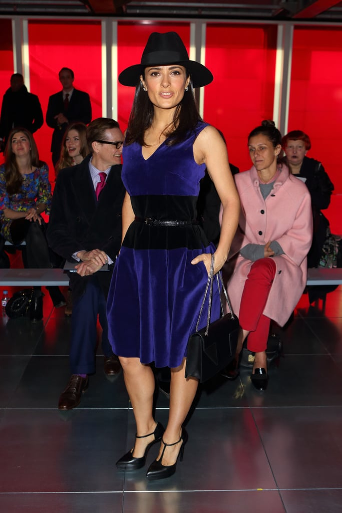 Salma Hayek paired a purple velvet Christopher Kane dress with a wide-brim hat, and t-strap pumps at the designer's show.