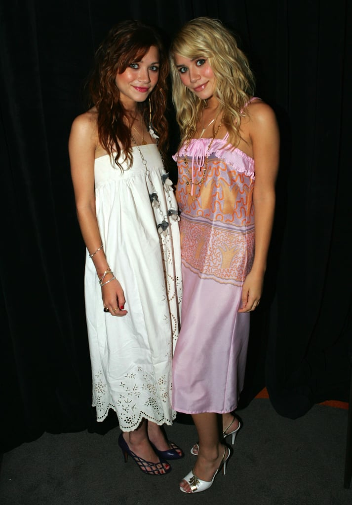Twinning combo: The girls brought their effortlessly cool style to the 2004 MTV Video Music Awards, styling ladylike dresses with a dash of flair.  Mary-Kate oozed boho-chic glamour in a strapless laser-cut dress, caged sandals, and a few floral accessories. Ashley styled a silky, printed pink dress with white sling-backs and breezy beach waves.