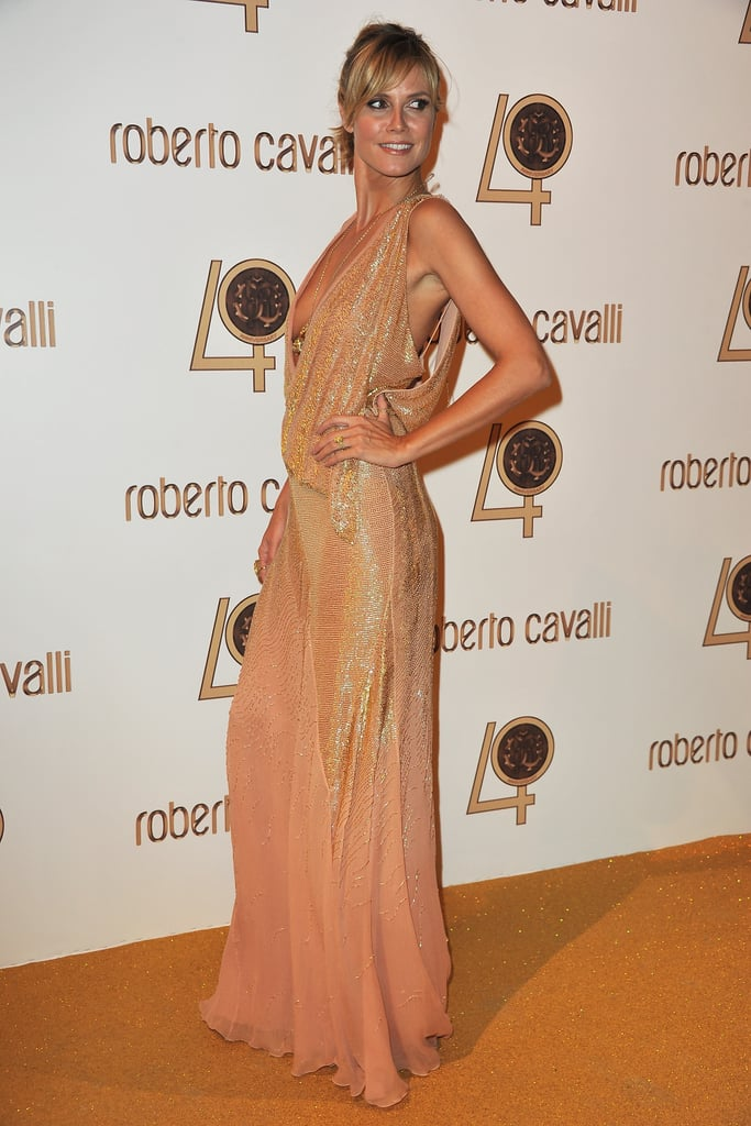 In shimmery, draped gold Heidi Klum has a total goddess moment.