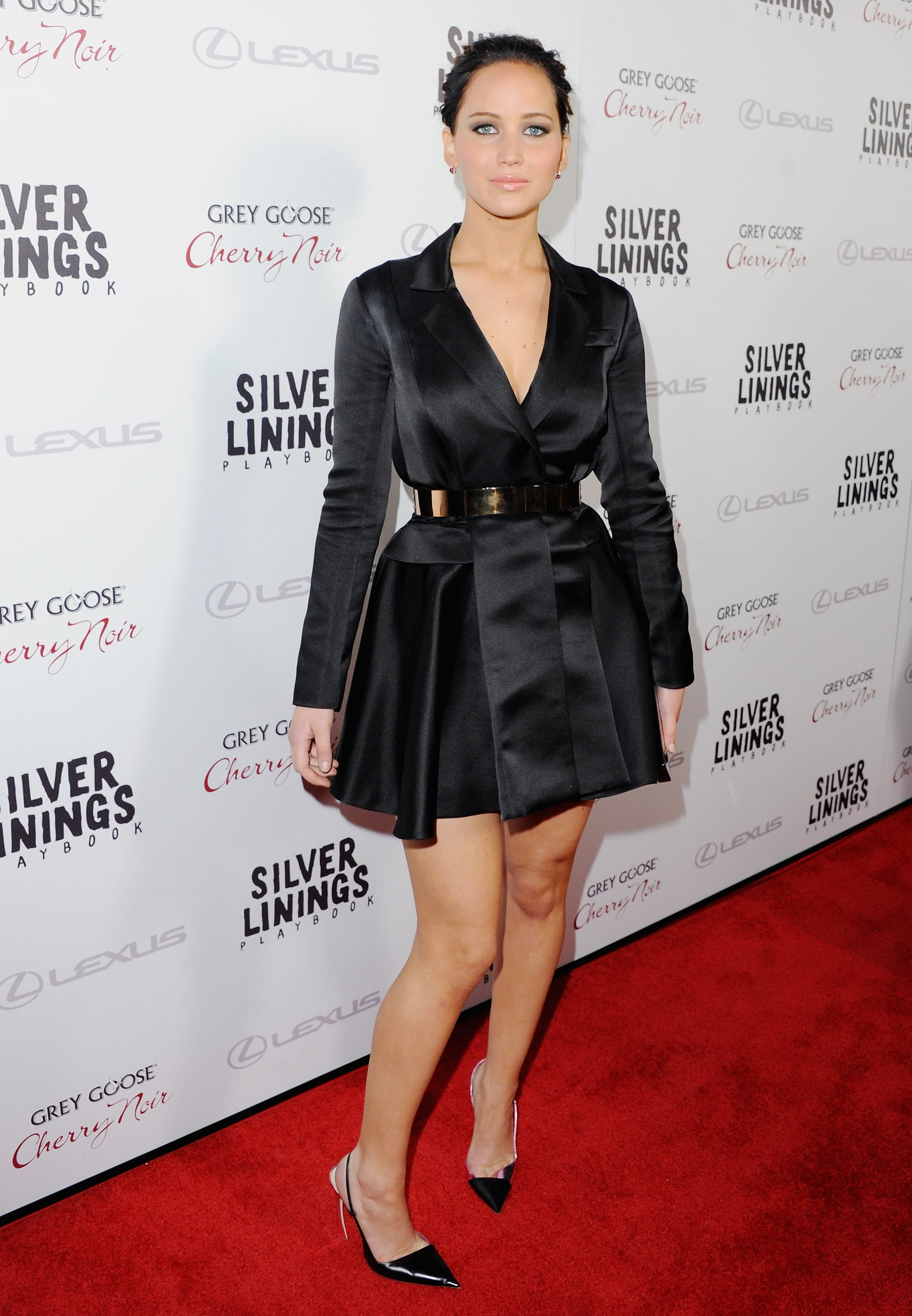 At the LA premiere of Silver Linings Playbook, Jennifer Lawrence showed us that yes, she can pull off a dress that looks like a coat — especially if it's accessorized with a metallic belt.