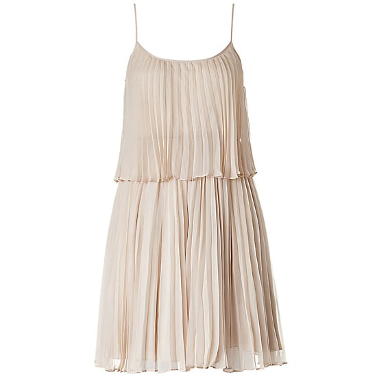 A little flapper, a little '70s, and so ethereal.  Halston Heritage Sand Pleated Silk Dress, $670