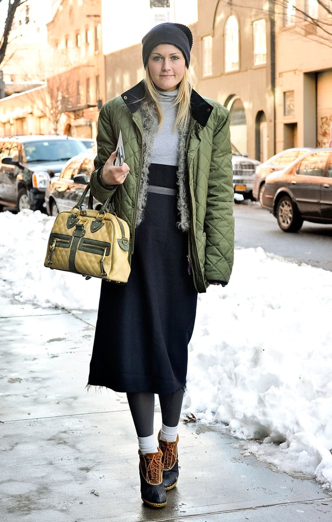 Play with proportions just like editor Mary Kate Steinmiller — a cropped jacket, long skirt, scrunched socks, and a slouchy beanie all work perfectly here.