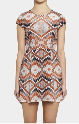 I'm a sucker for a punchy print! I can imagine wearing this on a balmy day with simple tan sandals and a pair of tortoiseshell shades.— Ali, FabSugar Editor. Dress, $379.95, Secret South from Green With Envy
