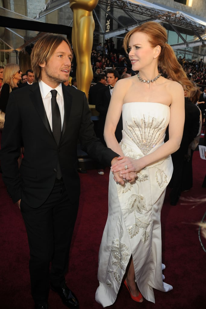 Holding hands at the 2011 Oscars.