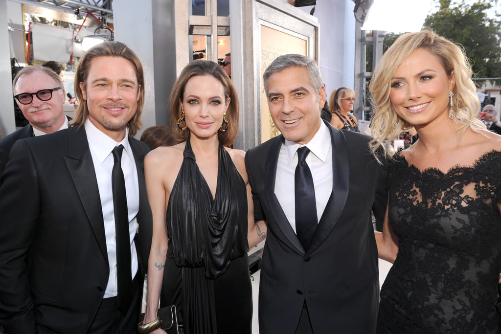 Angelina, Brad, George and Stacy stopped for a photo op.