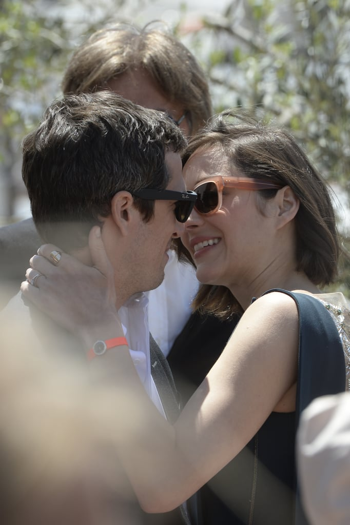 Marion Cotillard and her partner, Guillaume Canet, kissed at the Cannes Film Festival on Monday during a Blood Ties photocall.