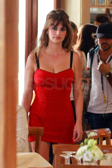 Penelope Cruz wore a sexy red dress on the set of her latest film.