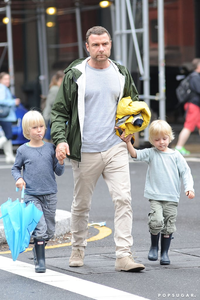Liev Schreiber held Kai and Sasha's hands in rainy NYC ahead of Mother's Day.