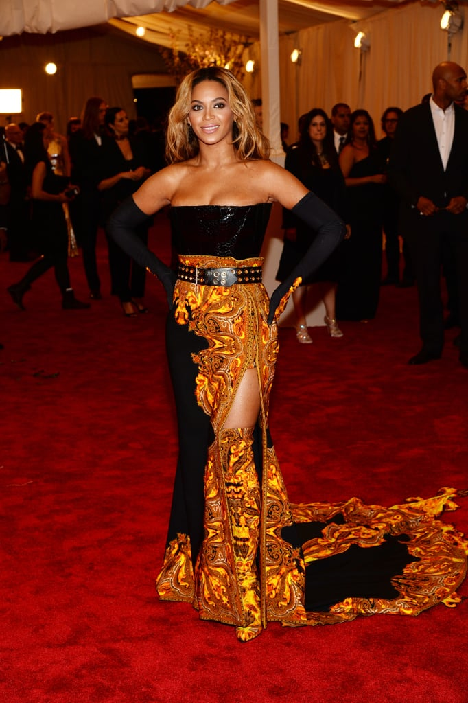 Beyoncé quite literally heated up the Met Gala arrivals with her flame-embroidered, custom-made Givenchy by Riccardo Tisci creation, which featured a leg-flaunting slit and thigh-high boots.