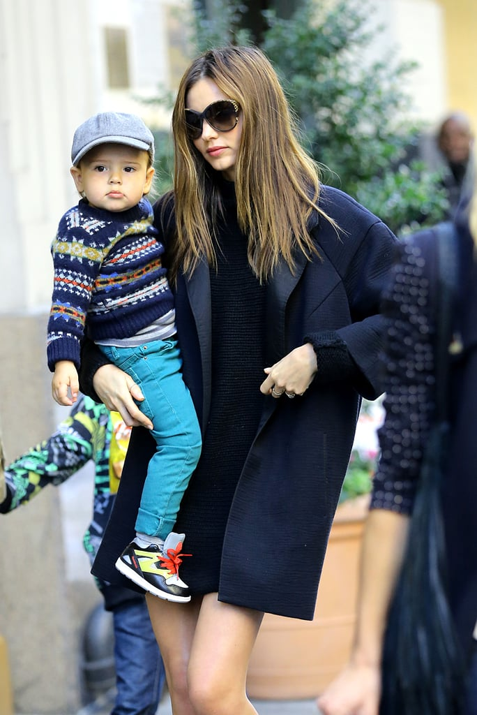 Miranda Kerr toted her cutest accessory, son Flynn, around as she left their apartment in New York on November 15.