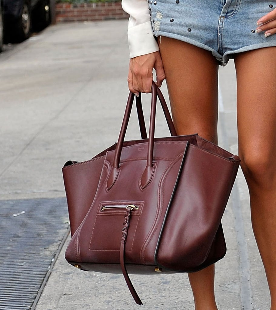 You already knew we were obsessed with the Céline tote — but in this oxblood color, especially so. Source: Greg Kessler