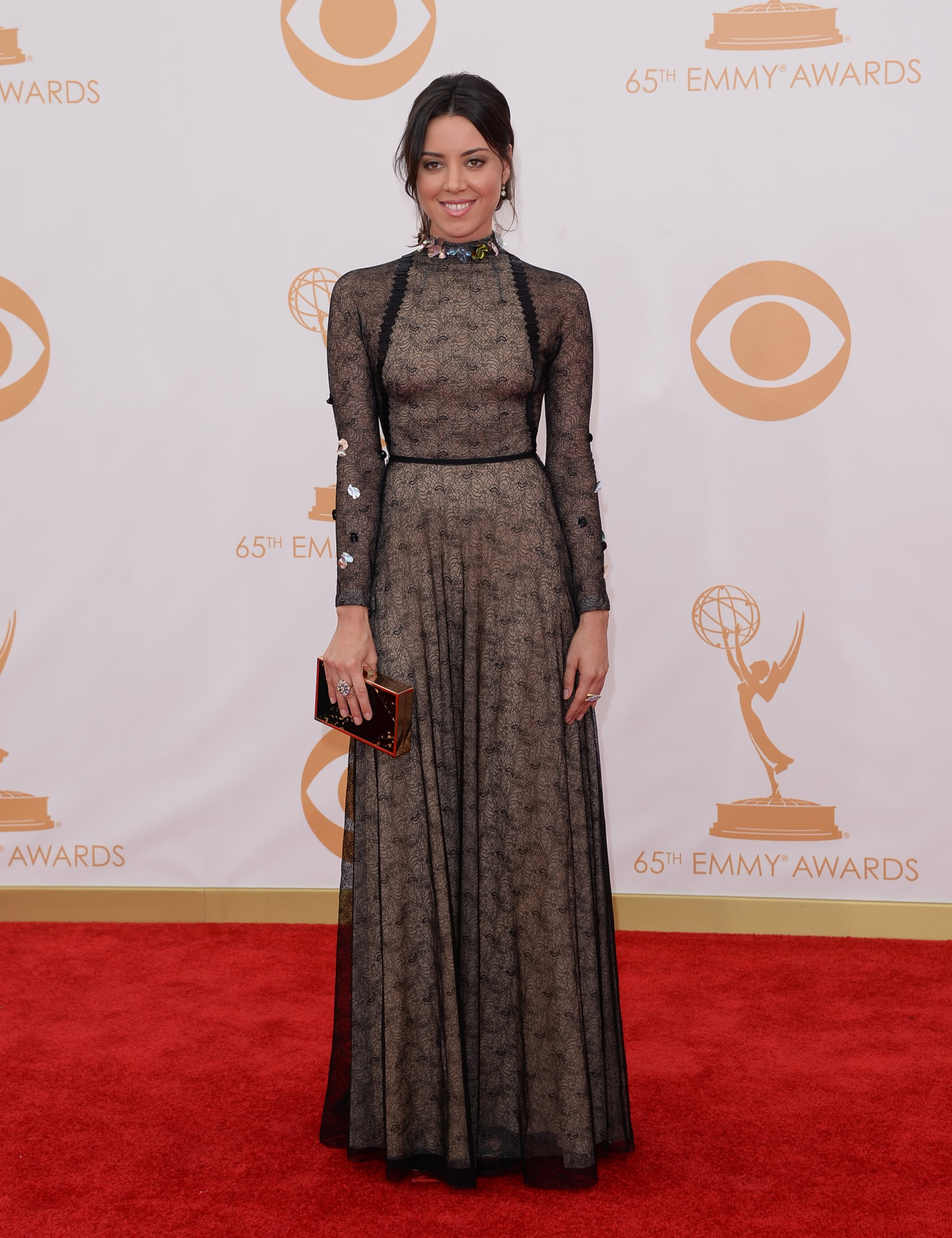 A high neck and long sleeves made Aubrey Plaza's Marios Schwab Resort 2014 dress downright demure.