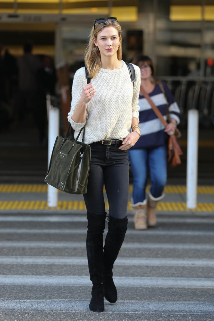 Karlie Kloss wore black knee-high boots as her statement piece and kept the rest of her outfit casual.