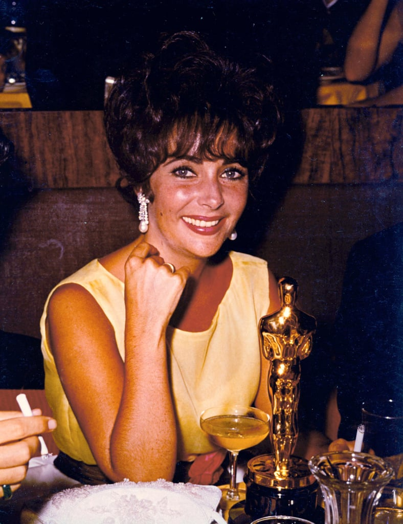 Elizabeth in 1961, posing with her Academy Award for best actress for Butterfield 8.