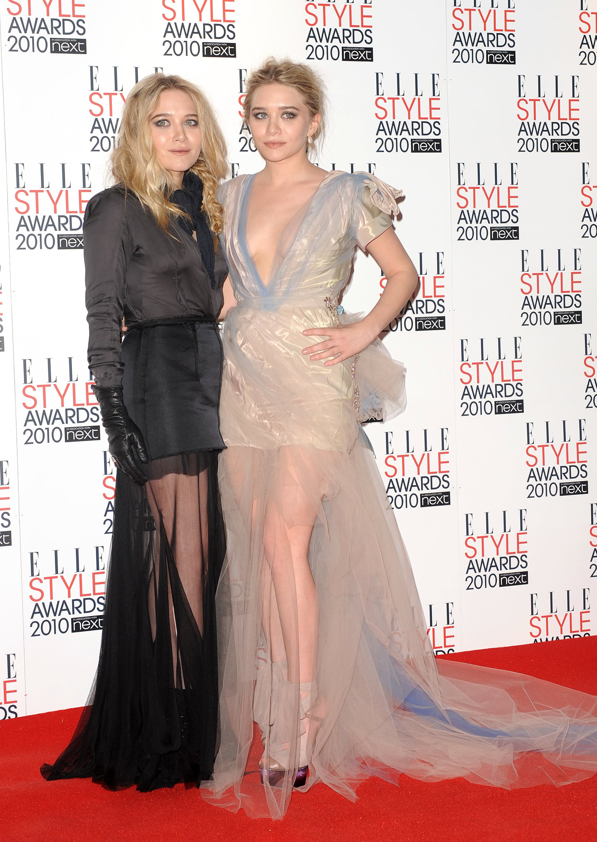Twinning combo: For the 2010 ELLE Style Awards, Mary-Kate and Ashley chose sexy sheer-overlay gowns.  Mary-Kate worked the darker angle in a black satin and tulle gown with black leather gloves and a knotted ascot. Ashley was wrapped up in a frothy Christian Lacroix creation, complete with a blue-streaked train, and tulle lace-up Fendi platforms.