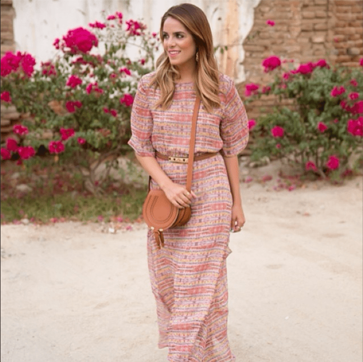 Dress up a maxi with a belt at the waist and a few great jewels. Just like that, the piece goes from daytime staple to best dressed wedding guest.  Source: Instagram user juliahengel