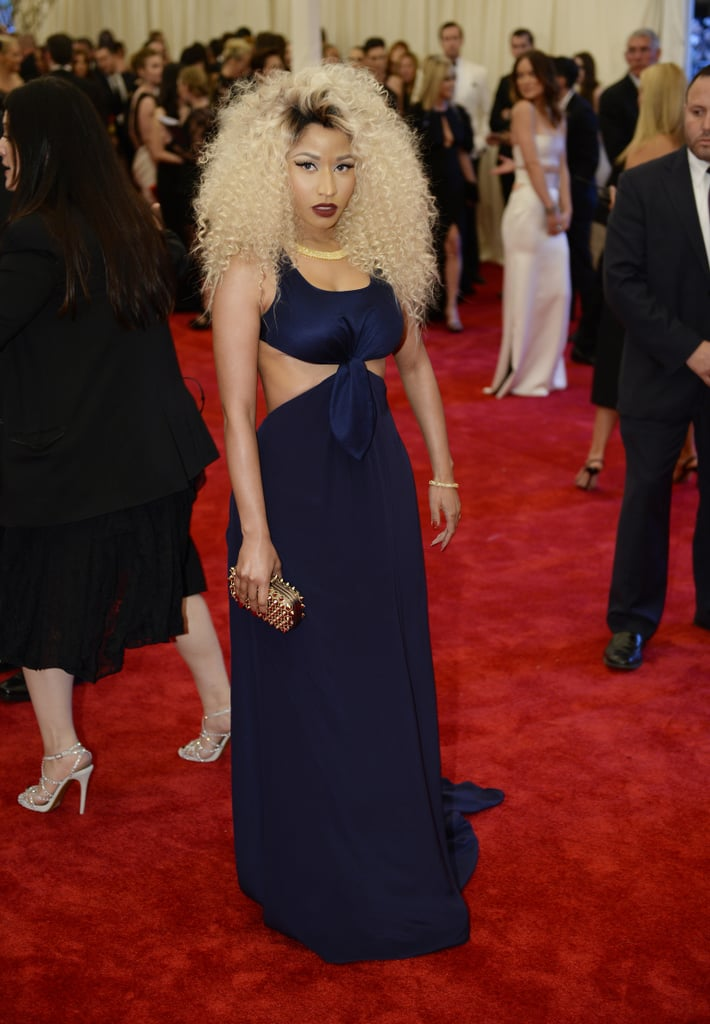 Nicki Minaj posed in her navy Tommy Hilfiger cutout dress and gold studded clutch.