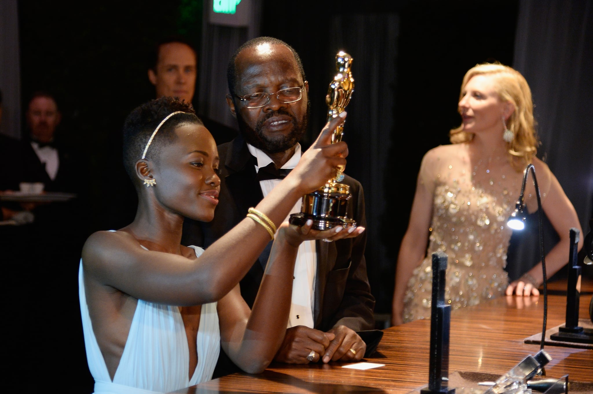 Lupita gave her award a once-over.